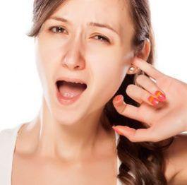 Симптомы гула в ухе